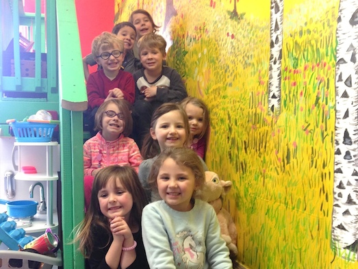 Pre-K kids on mural stairs
